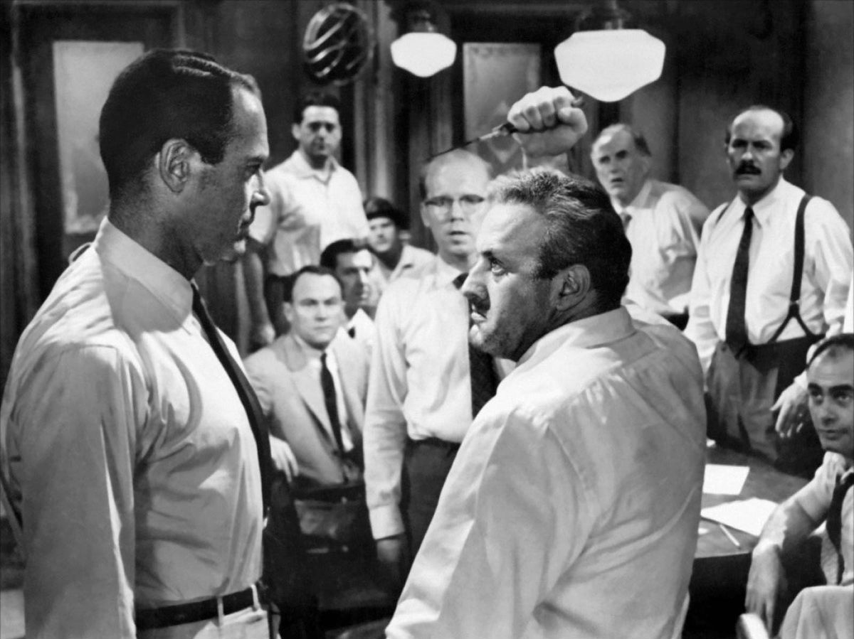 Henry Fonda (foreground, left) and Lee J. Cobb (right) in12 Angry Men.