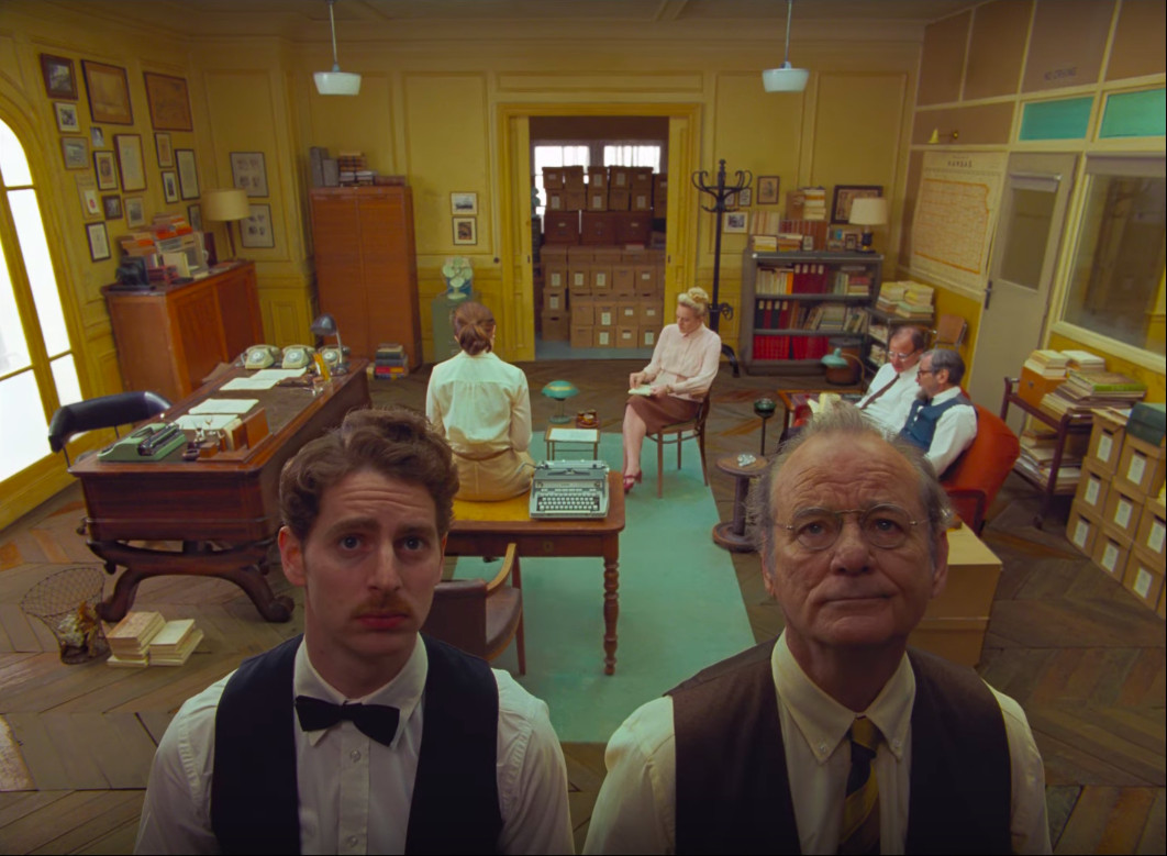 Bill Murray and other cast in The French Dispatch.