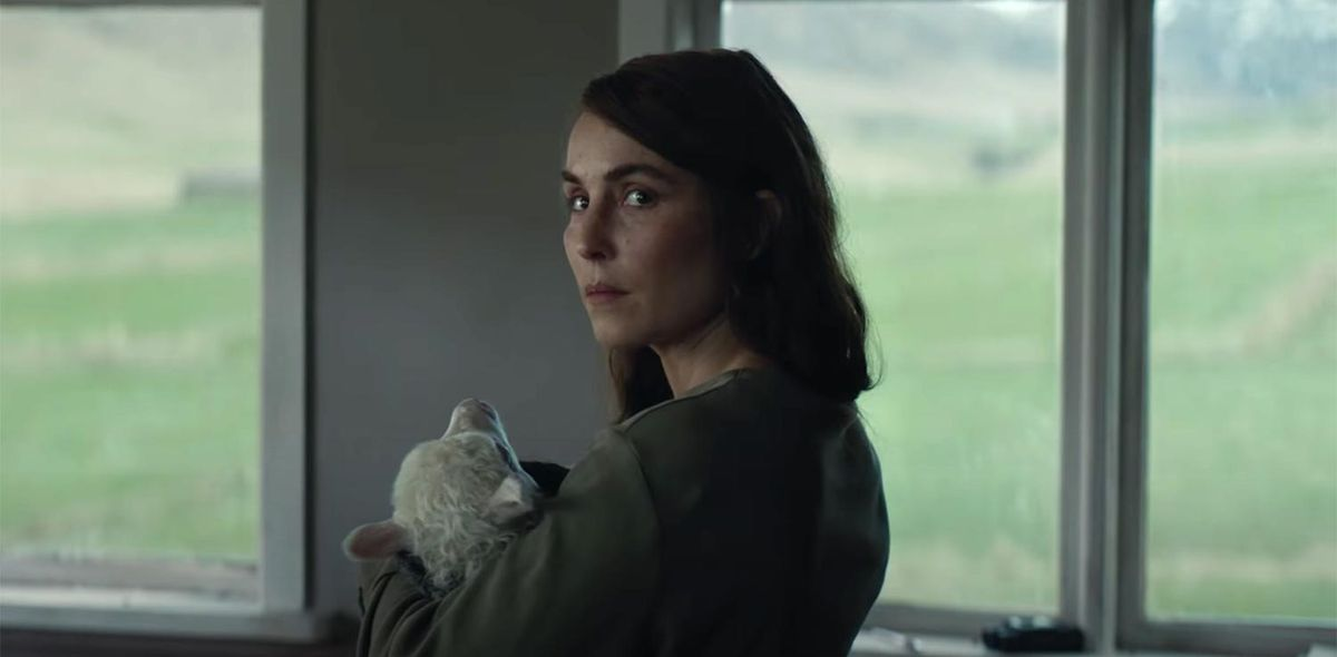 Noomi Rapace holding a lamb-headed child in Lamb