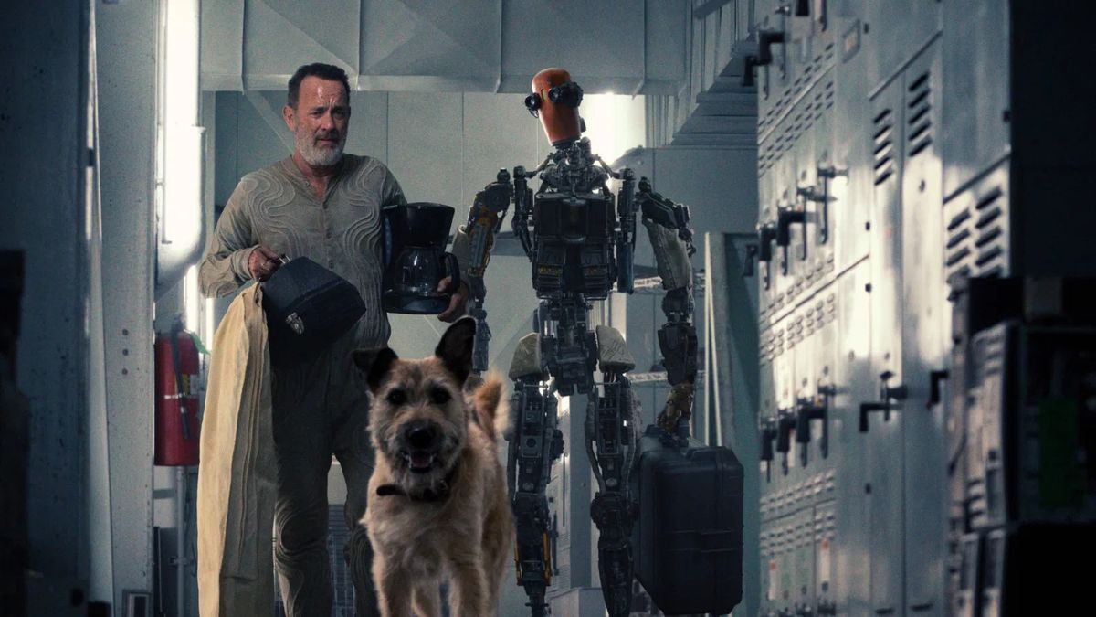 Finch (Tom Hanks) walks besides his robot Jeff (Caleb Landry Jones).